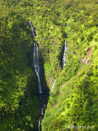 Bird's eye view of a waterfall on Maui, Hawaii, flying over in a helicopter.