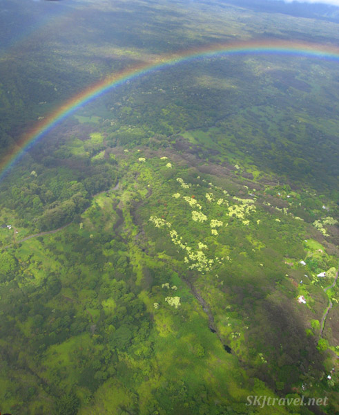 A rainbow beneath us as we fly over the landscape on Maui, Hawaii, in a helicopter.