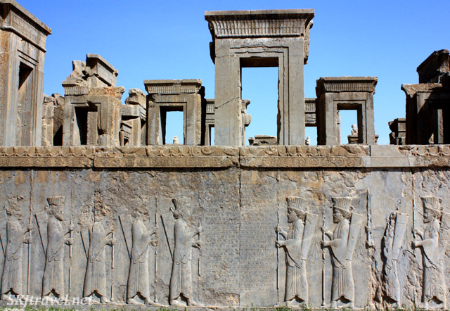 Bas relief figures along the base of a palace complex at Persepolis, Iran.