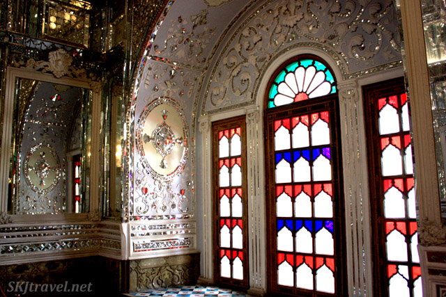 Light coming through stained glass windows reflecting off mirrors. Palace grounds, Tehran, Iran.