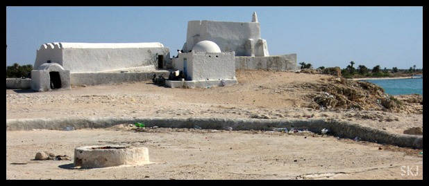 White buildings are the set for mos eisley spaceport in Star Wars movie.