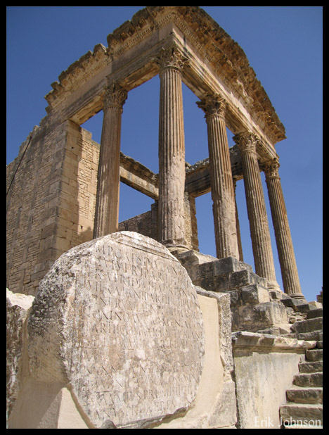 Ancient roman temple remains, pillars and square walls, Dougga Tunisia.