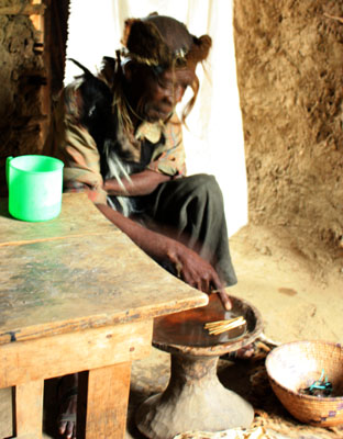 Traditional witch doctor inside his home in the lower Rwenzoris, Uganda