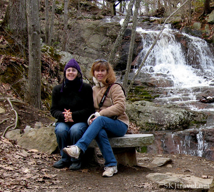Two girls sitting on a bench at Jewel Falls, Maine.