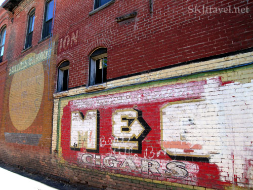Old brick building with advertisement for cigars painted on it. Glenwood Springs, Colorado.