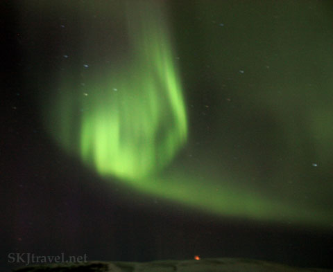 Green aurora borealis, northern lights, in a spiral shape outside Reykjavik, Iceland. Photo by Shara Johnson